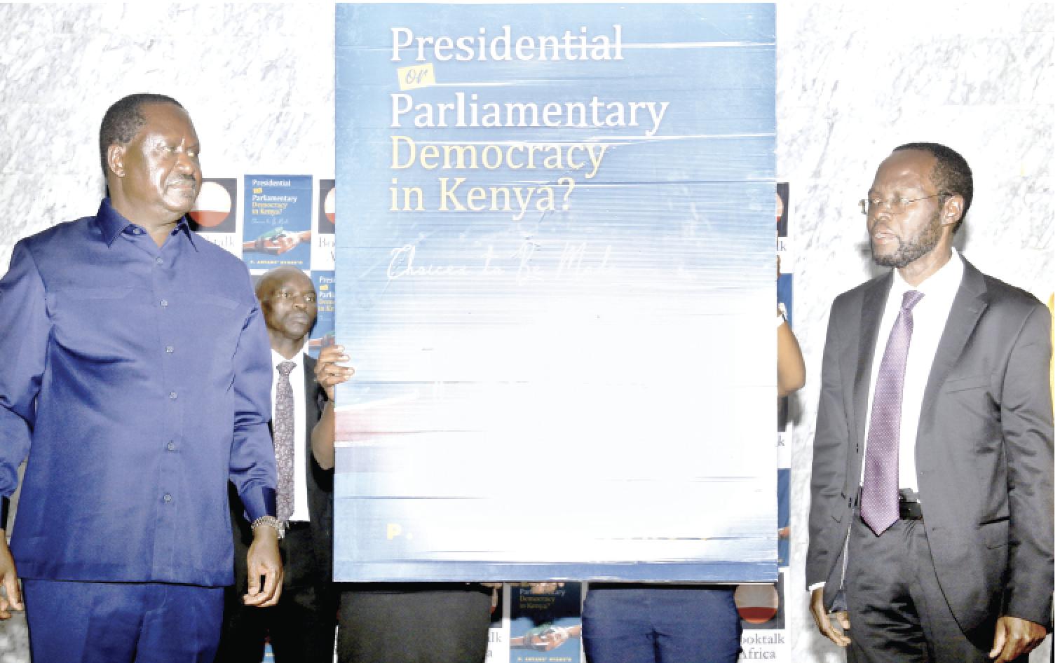 Opposition leader Raila Odinga (left) with Kisumu Governor Anyang' Nyong'o during the launch of the latter's book at the University of Nairobi on Tuesday. PD/TIMOTHY NJENGA
