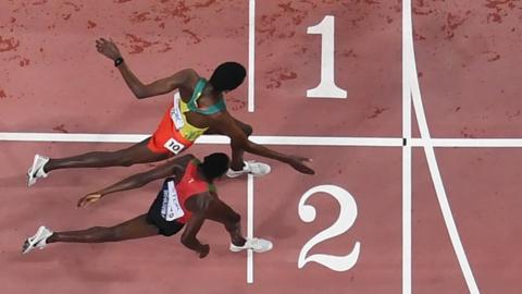 Kenya's Conselsius Kipruto (bottom) narrowly beat Ethiopia's Lamecha Girma